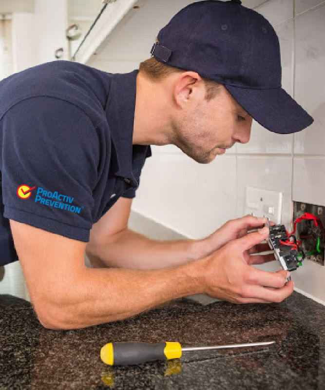 Electrician in Chicago fixing an outlet